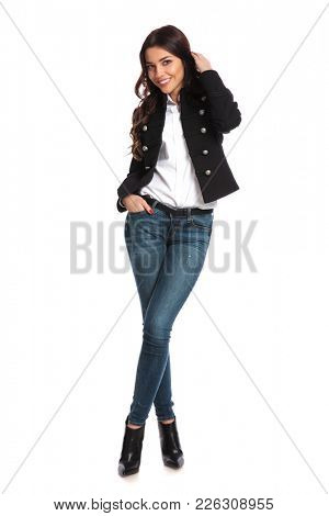 cute young casual woman standing on white background