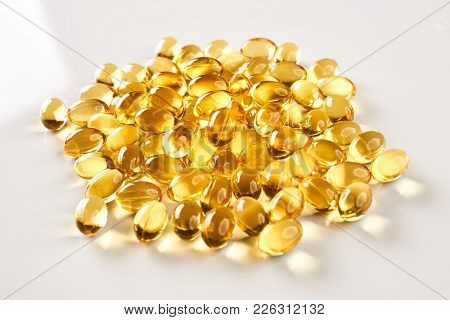 Fish Oil Pills Close-up. Cod Liver Oil Omega 3 Gel Capsules Isolated On White Background. Medical Pi