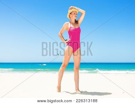Happy Modern Woman On Seashore Looking Into Distance