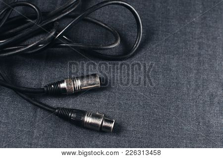 Xlr, Connector With Wires On A Dark Fabric Background In The Studio