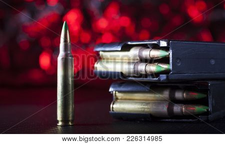 Magazines And Ammunition For An Ar-15 With A Red Background