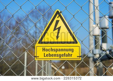 Yellow sign high voltage Danger to life