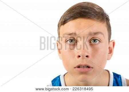Teenage Boy Headshot Looking Scared Agaisnt A White Background