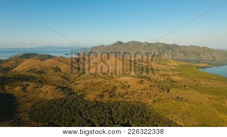 Tropical Landscape, At Sunrise Time With Mountains, Tropical Forest, Bay, Mangrove Forest. Aerial Vi