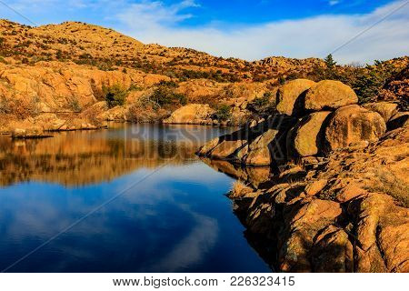 Early Morning Breeze Distorts Rocky Reflection In Water At Wichita Mountains National Wildlife Refug