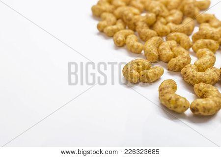 Peanut Snacks Isolated On White Background. Peanut Flavored Flips. Puffed Snacks As Background. Pean