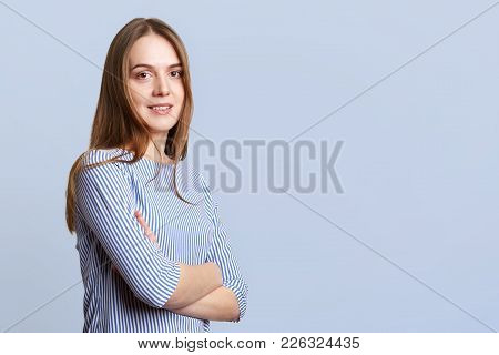 Sideways Portrait Of Glad Beautiful Young Woman With Long Dark Hair Wears Ellegant Striped Blouse, K