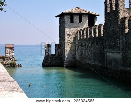 Beautiful View On Lake Garda With The Wall Of Sirmione Castle