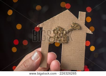 Key On Paper House On A Bokeh Light Background