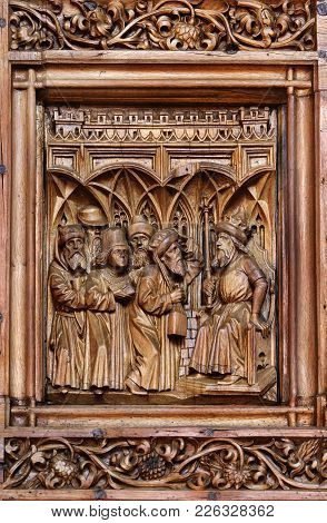 Wood Carving Of Bible Story On The West Door Of Cathedral, Constance, Germany