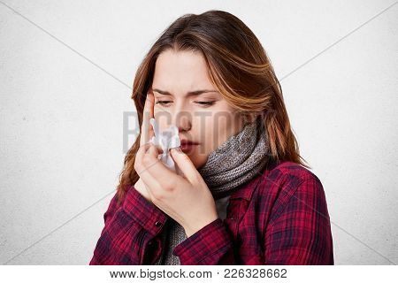 Sick Female Blows Her Nose In Tissue, Looks Ill And Exhausted, Has Terrible Headache, Running Nose,