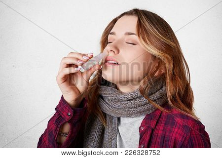 Sick Pretty Woman Has Blocked Nose, Dripps Nasal Drops, Suffers From Running Nose, Isolated Over Whi