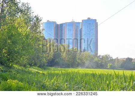 Summer landscape and residential skyscraper in microdistrict Ribatskoe on the outskirts of St. Petersburg, Russia. poster