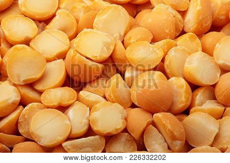 Dried Yellow Pea Split Background Texture Top View.selective Focus.