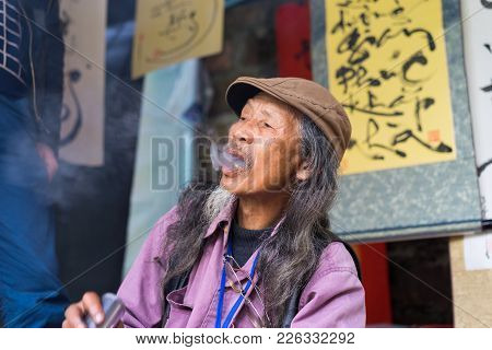 Hanoi, Vietnam - Feb 15, 2015: Vietnamese Scholar At Lunar New Year Calligraphy Festival Organizing