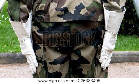 Rear View Of Military Solider In Camouflage White Gloves Ceremony To Mark Western Allies World War T