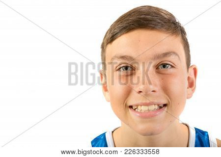 Teenage Boy Headshot Looking Happy Agaisnt A White Background