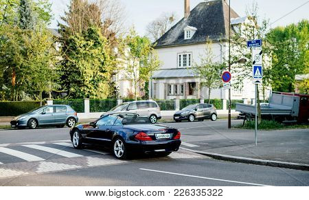 Paris, France - Apr 7, 2017: Luxury Mercedes-benz Sl Cabriolet Convertible Roadster With Senior Driv