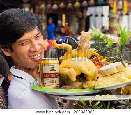 Quang Ninh, Vietnam - Mar 22, 2015: Vietnamese Man Carries Offerings To Cai Bau Temple .visiting Pag