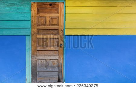 Grunge Old Door With Color Painted Wall. Classical Vintage And Modern Interior Concept. Architecture