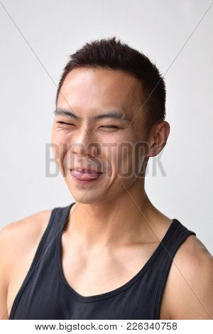 A Portrait Of An Asian Chinese Male Making A Shy Expression
