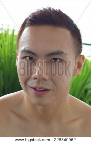 A Portrait Of A Chinese Asian Man Smiling