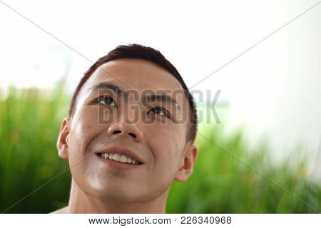 A Headshot Of An Asian Chinese Male Looking At Sky