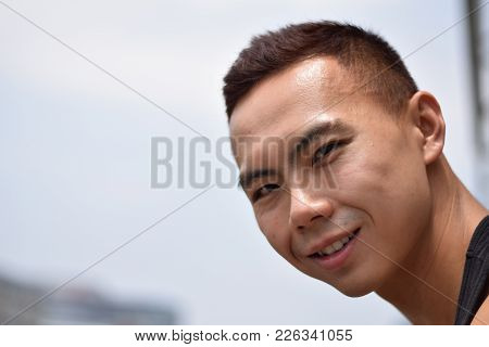 A Young Asian Chinese Smling At Camera