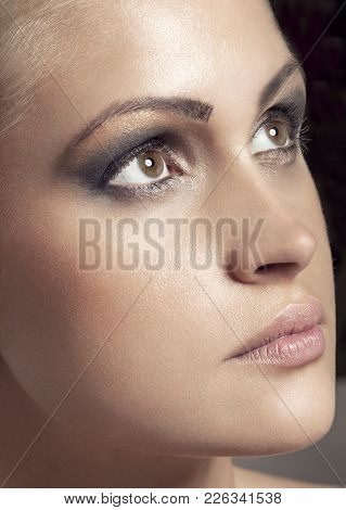 Beautiful Woman Girl Natural Makeup Portrait With Smokey Eyes On Dark Background