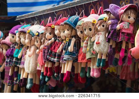 Hanoi, Vietnam - Oct 25, 2015: Cloth Dolls For Sale On Hang Ma Street. The Street  Is Famous For Sel
