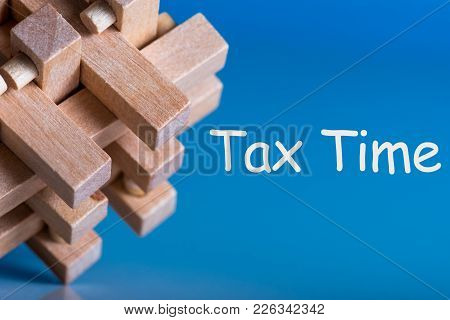 Tax Time - Brean Teaser Or Puzzle With Notification Of The Need To File Tax Returns, Tax Form.