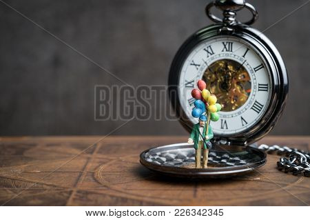 Happy Retirement Time Countdown Concept, Senior Old Man Holding Balloons Standing On Vintage Pocket
