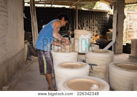 Hanoi, Vietnam - Jan 2, 2016: Inside A Pottery Clay Production Workshop In Bat Trang Ancient Ceramic