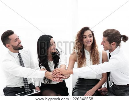 successful business team with hands clasped together