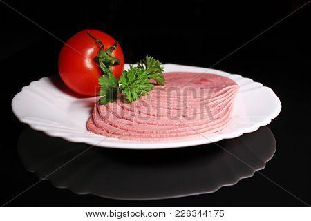 Sliced Ham Pork Meat On Black Reflective Studio Background. Isolated Black Shiny Mirror Mirrored Bac