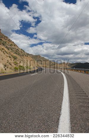 A View Down A Mountain Highway Somewhere In The American Southwest.