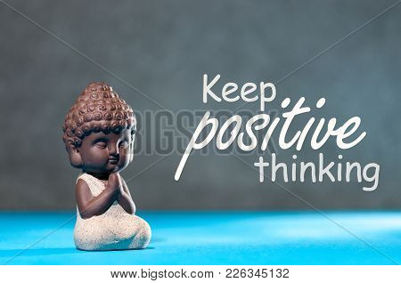 Keep Positive Thinking - Motivating And Inspiring Concept With Meditating Little Buddha.
