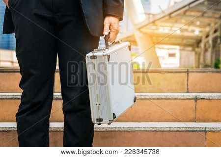 Business Man Holding Metallic Briefcase