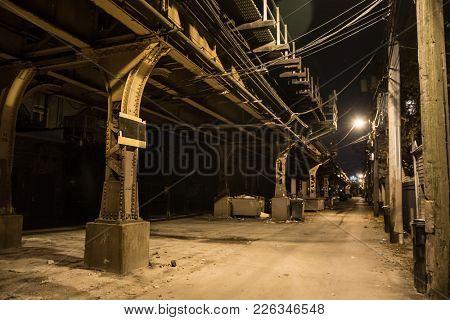 Dark city alley at night.