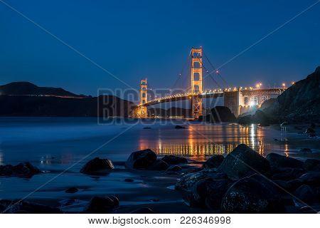 Illuminated Golden Gate Bridge In San Francisco In California Usa. Long Exposure Panoramic Photo. Ho