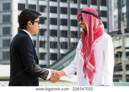 Arab Man And Businessman Handshake