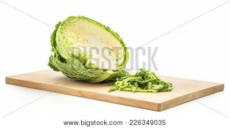 One Savoy Cabbage Half On A Chopping Board With Fresh Green Chopped Leaves Isolated On White Backgro