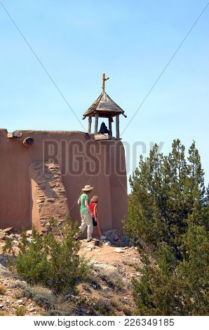 Bell Tower On Adobe Church