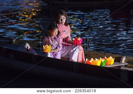 Hoi An , Vietnam - Oct 04 : Vietnamese Mother And Daughter Holding Lanterns Before Droping Them Into