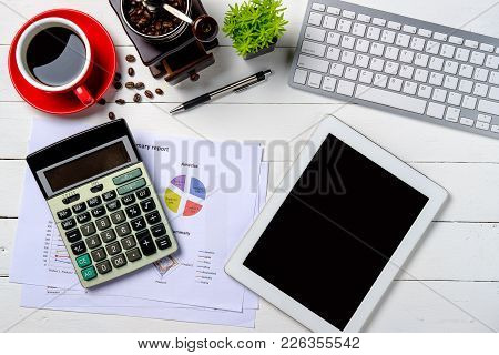 Modern White Office Desk Table With Keyboard,pen,calculator,tablet,financial Data Or Graph Or Chart