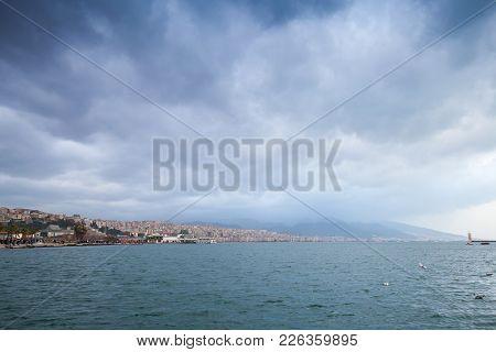 Coastal Cityscape Under Cloudy Sky. Izmir, Turkey