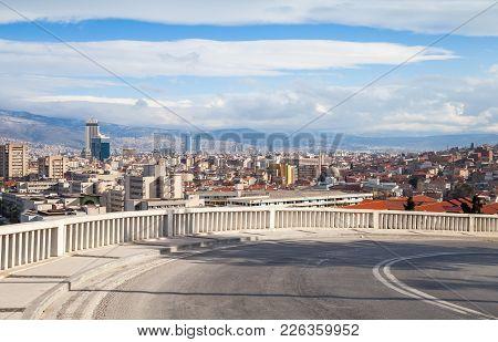 Skyline With Modern Buildings And Mountains Under Cloudy Sky. Izmir City, Turkey