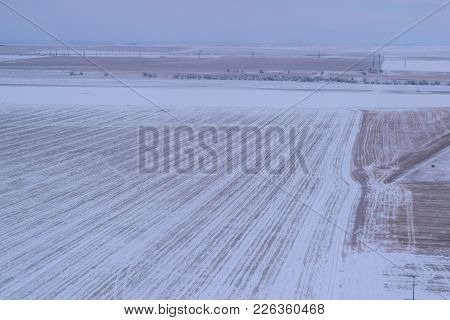 Rural Desolate Landscape Covered In Snow During A Blizzard Taken On Farmland In The North American G