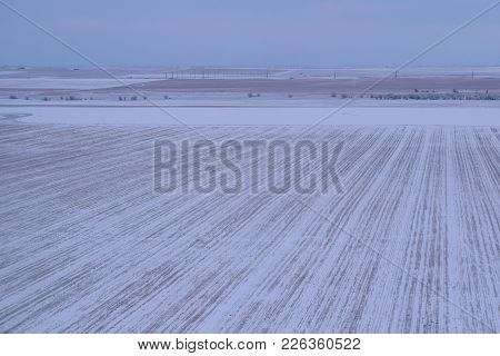 Great Plains Including Farmland Covered In Snow During A Blizzard Taken In The Rural North American