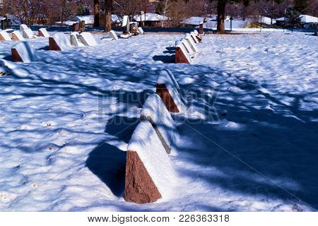 Haunting Image Of Old Headstones Covered In Snow After A Blizzard Taken In A Community Cemetery